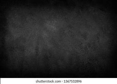 Black background, dark slate texture. Stone surface Vignette