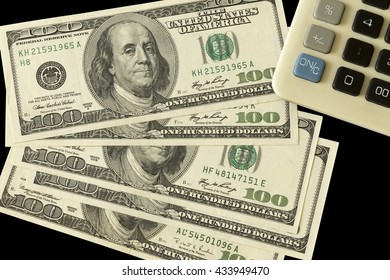 Black background with money American dollar bills, with calculator