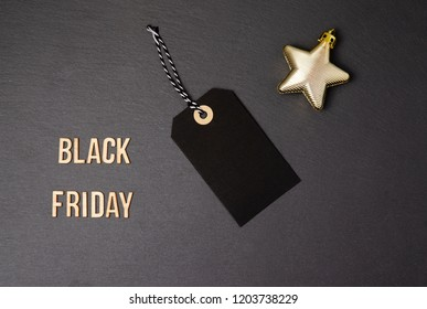 Black background and price label.  Black Friday. Sales concept. Copy space.  Black paper label against a dark grey background. Black Friday shopping sale concept with ticket Sale tag close