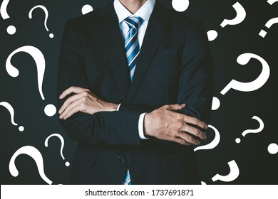 Black background with question mark and businessman in suit