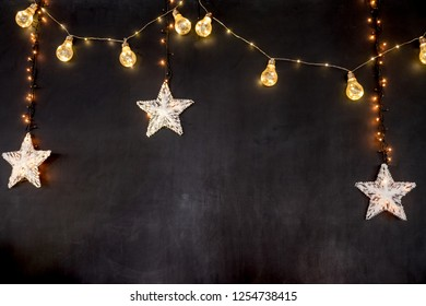 black background with stars and light