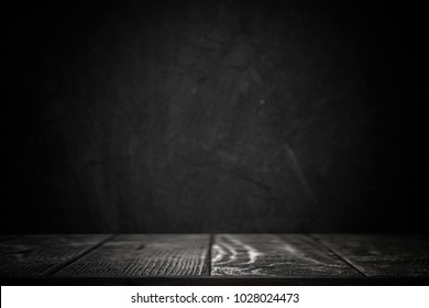 Black background with table top