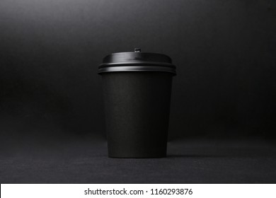 Black background takeaway coffee cup