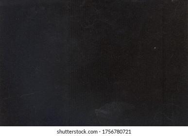 Black background. Velvet fleecy paper texture. Closeup