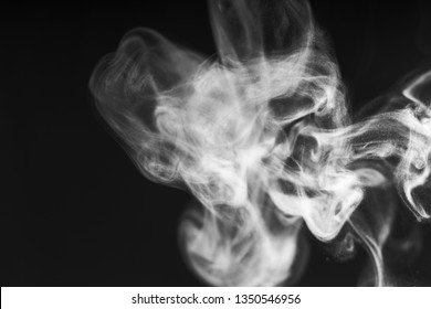 Black background with white smoke mist overlay effect. Nature motion use for steam swirl wave, hot coffee tea in cup, cigarette, gas, dry ice with copy space for banner