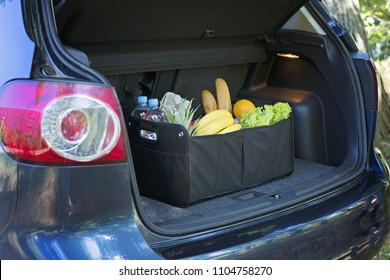 Black bag basket full of products in the car trunk