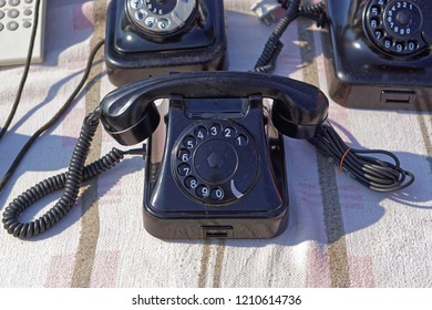 Black bakelite retro telephone at flea market