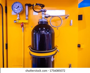 Black ballon for gas storage. Concept - ballon for air supply. Ballon is mounted next to pressure sensor. Concept - sensor shows gas pressure. Industrial equipment. Cylinder black. Chemical equipment