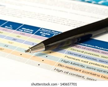 Black ballpoint pen with data document