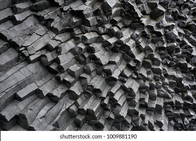 Black basalt column formation in Iceland. Closeup. Horizontal.