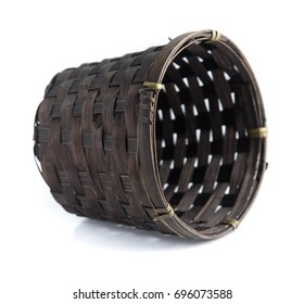 Black basket made from bamboo on a white background.