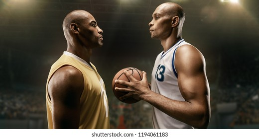 Black basketball players on big professional arena before the game. Two teams. Players collided face to face. Player holds a ball