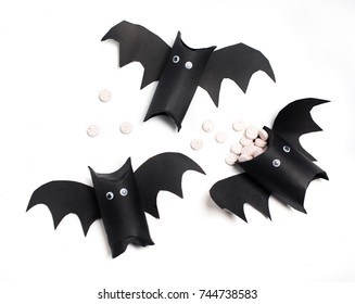black bats from rolls on toilet paper. DIY fun with kids, sweets for halloween