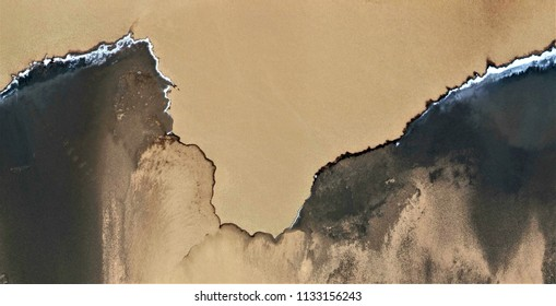 black beach, black gold,polluted desert sand,tribute to Pollock, abstract photography of the deserts of Africa from the air, aerial view, abstract expressionism, contemporary photographic art