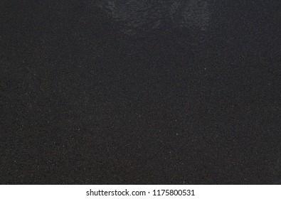 Black beach sand background