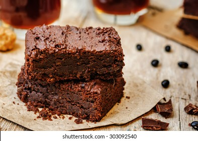 black bean brownies on a dark wood background. the toning. selective focus