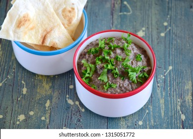 black bean dip with parsley served with tortilla chips