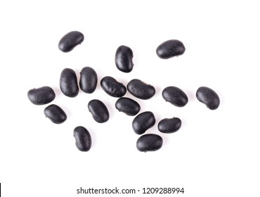 black beans isolated on white background. top view