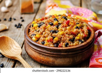 black beans, quinoa and corn chili on a dark wood background. the toning. selective focus