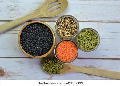 Black beans, red lentils, green lentils, quinoa, pumpkin seeds, hemp seeds, and chia seeds.