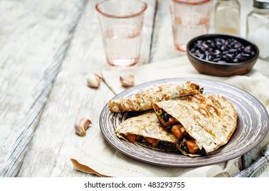 Black beans spiced sweet potato quesadilla. toning. selective focus
