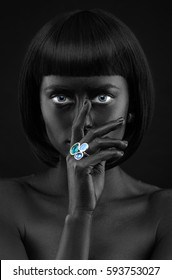 Black Beauty face. Fashion portrait of a dark-skinned beautiful girl with jewerly.