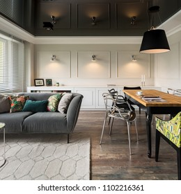 Black and beige home interior with dining and living room combined