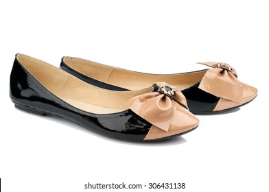 Black and beige shoes isolated on white background.