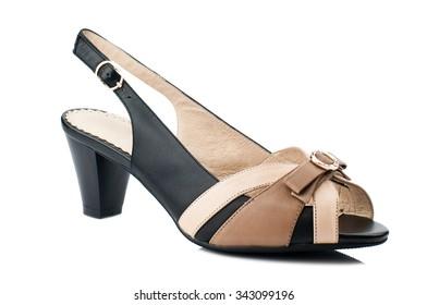 2b4d72e3eca Black and beige women shoe isolated on white background.