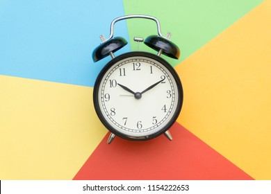 black bell clock with colorful color