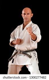 black belt karate man portrait