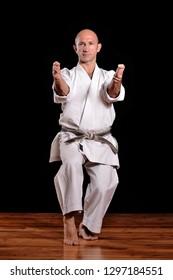 black belt karate martial arts man on black