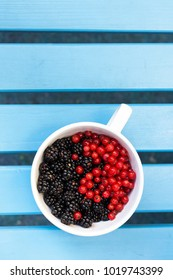 Black berries and red current in a bowl or cup