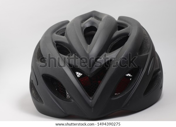 Black bicycle helmet on an isolated background