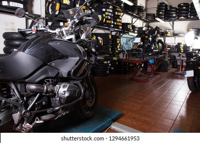 black bike in motorcycle workshop