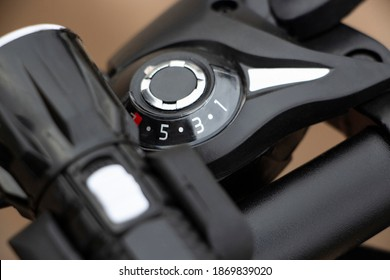 Black bike speed derailleur on steering wheel
