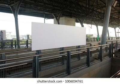 Black billboard banner in the train station for advertising mockup .