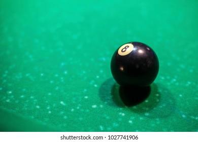 black billiard ball on the table, number 8