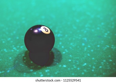 black billiard ball on the table, number eight, retro toned