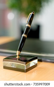 Black biro on a table with beautiful office background bokeh