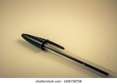 A black biro on a white background.