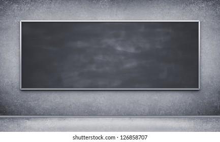 Black blackboard in concrete room