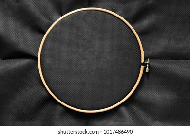 Black blank canvas on wooden round frame as a background
