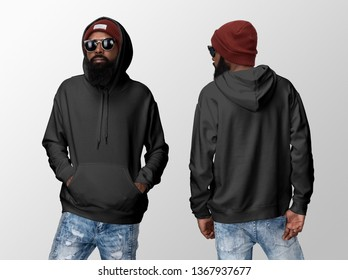 Black blank hoodie on a young african american man in jeans, isolated on a white studio background, front and back view mockup of black hoodie with place for your logo or design