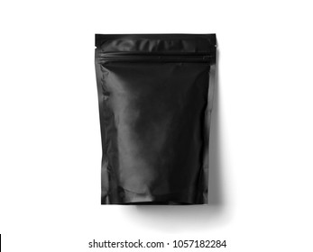 Black Blank paper bag for tea, coffee and grain packaging. Retail shopping and advertising concept. Isolated on a white background. Detailed closeup studio shot