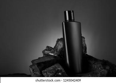 Black Blank Product Bottle on Black Stone for Mockups