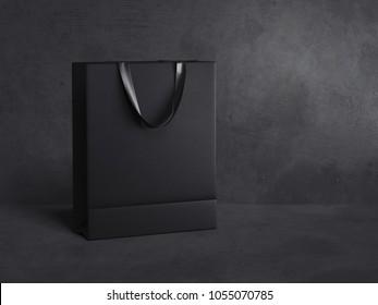 Black blank shopping bag isolated on dark background. 3d rendering