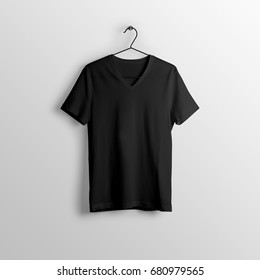 Black blank v-neck t-shirt mockup on hanger, hanging against empty wall background.
