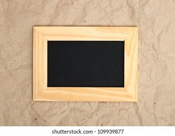 black blank in wooden frame on old paper