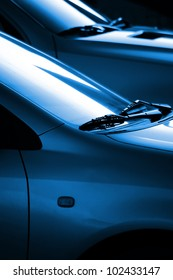Black and blue image with the detail of the windshield wipers of two cars
